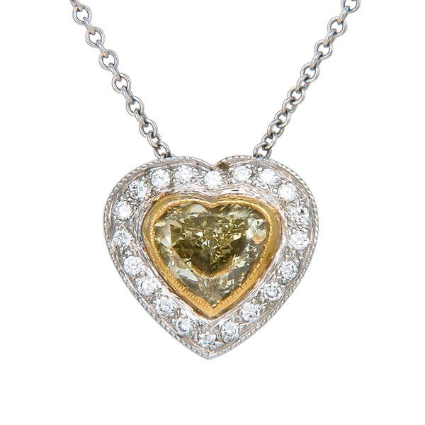 View Heart Shape Natural Yellow Diamond Pendant With a Micro Pave Diamond Halo Set in 14k White Gold