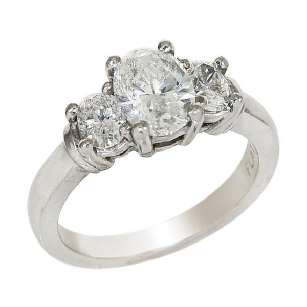View Oval Three Stone Diamond Engagement Ring in Platinum
