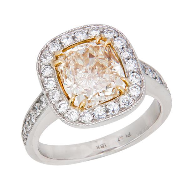 View Halo Style Cushion Shape Natural Fancy Yellow and White Diamond Ring Set in Platinum