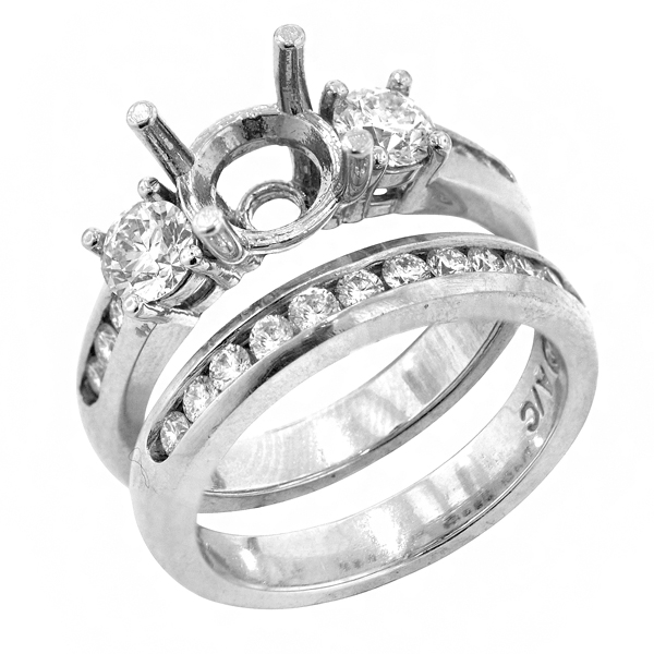 View Round Three Stone Diamond Bridal Set in Platinum