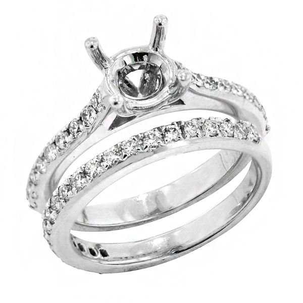 View Traditional Four Prong Diamond Bridal Set Engagement Ring in Platinum