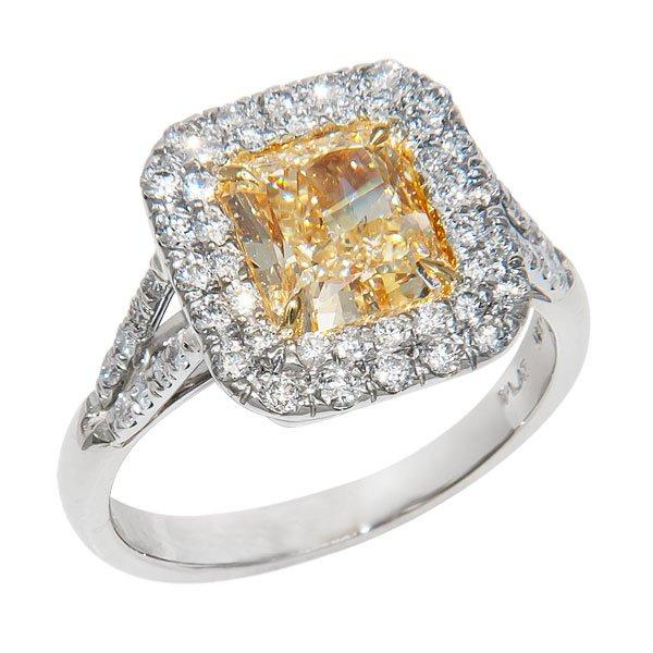 View Natural Fancy Light Yellow and White Diamond set in a Halo Style with Platinum and 18k