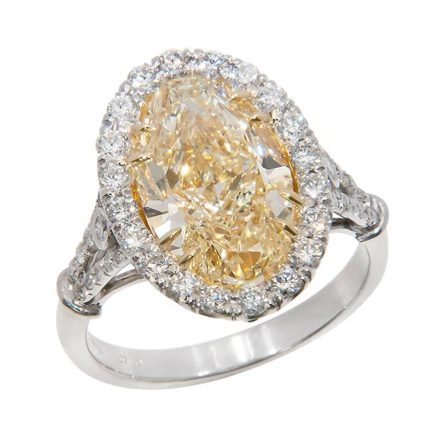View Split Shank Halo Style Oval Shape Natural Fancy Yellow and White Diamond Ring Set in Platinum