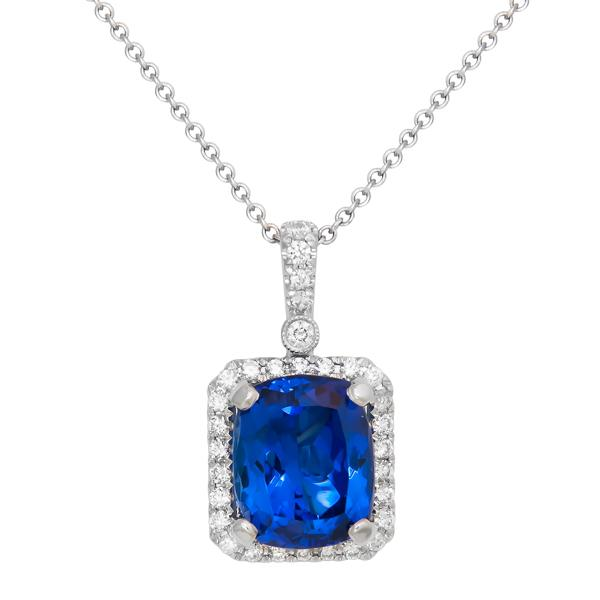 View Gem Quality Cushion Shape Tanzanite and Diamond Pendant Set in 18K White Gold with a Halo Design