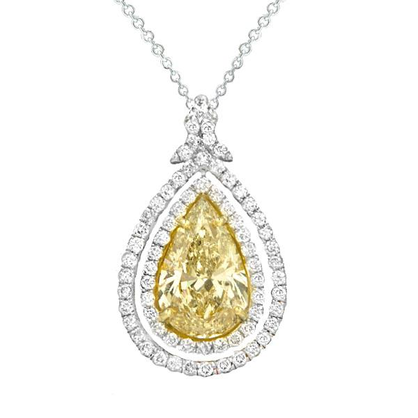 View Custom Made Pear Shape Natural Yellow and White Diamond Penadant Set in a Double Halo Style Setting