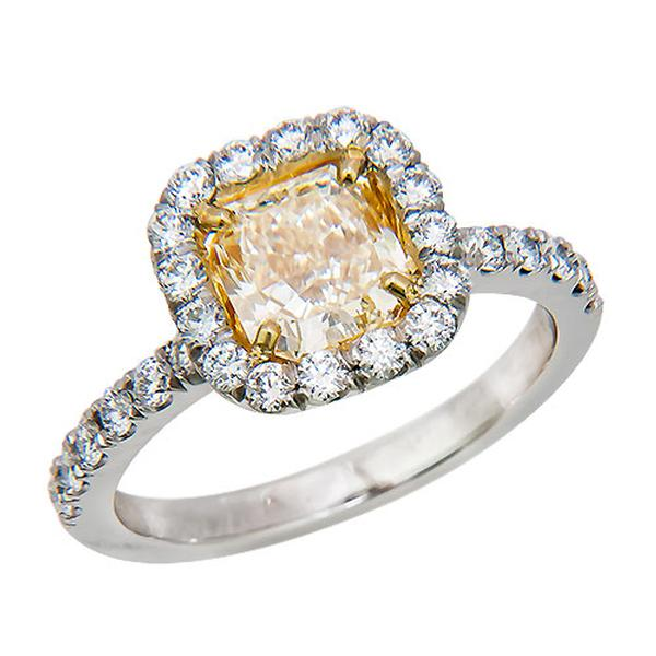 View Natural Radiant Shape Yellow Diamond Set in Custom Made Platinum Halo Design
