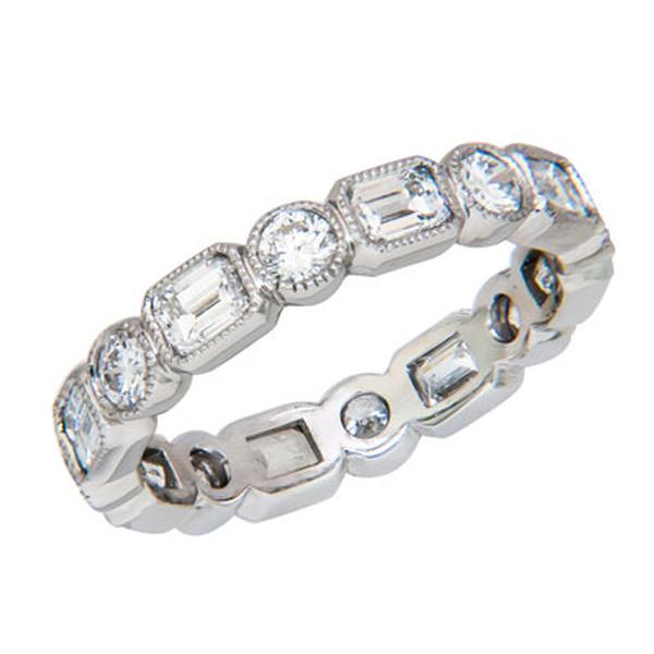 View Custom Made Diamond Eternity Band With Emerald Cut and Round Diamonds Set in Platinum