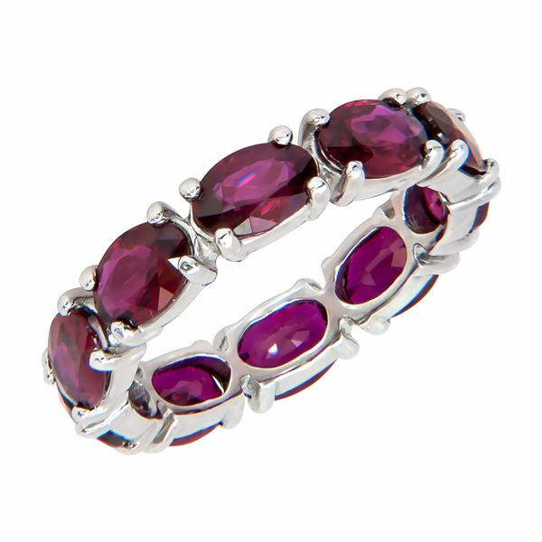 View Custom Made Oval Shape Ruby Eternity Band set in Platinum