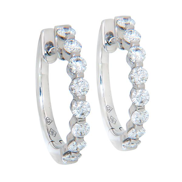 View Dime Size Diamond Hoops With a One Prong Share Design Set in 18K White Gold