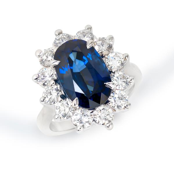 View Sapphire and Diamond Ring Set in 14K White Gold Halo Design.  Inspired by Princess Diana and Princess Kate's Ring.