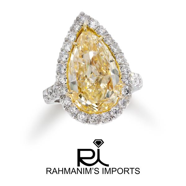 View Custom Made Fancy Yellow Pearshape Ring set in a Halo Design
